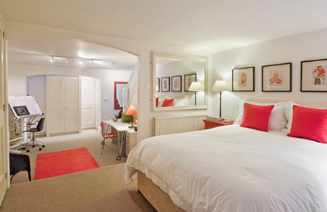 neutral bedroom with striking red highlights