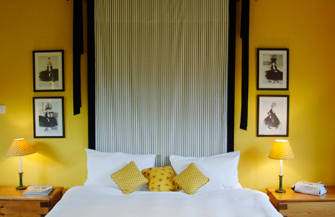 bold yellow bedroom with oriental feel