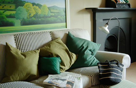 classic green living room with different textured cushions