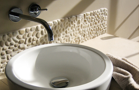 pebble tiles in simple small bathroom